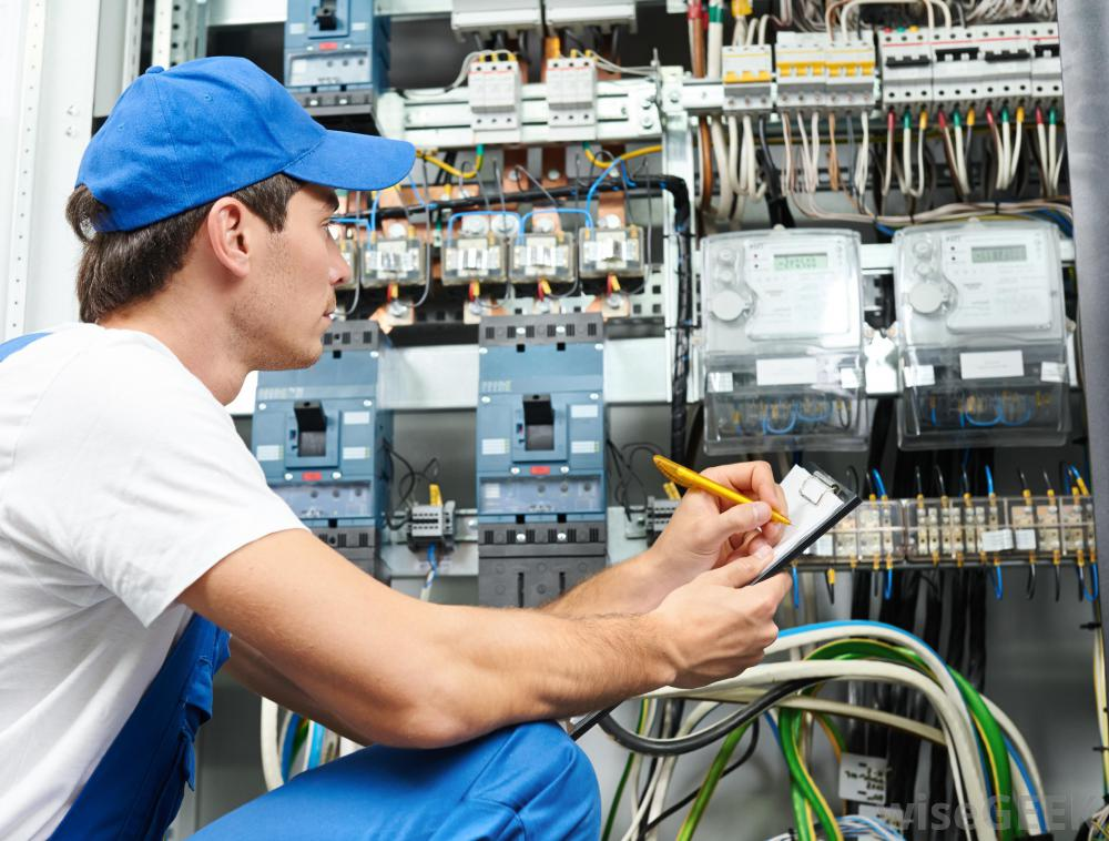 man-in-blue-hat-looking-at-wires